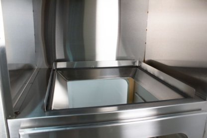 ENVIROPASS® Stainless Steel Ventilated Pass-Through Fan Filter Unit shown uninstalled to display FFU mount detailand side HEPA filter vent