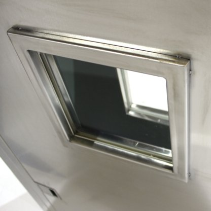 Close-Up View of Ceramic Window in EnviroPass® Fire Resistant Stainless Steel Floor-Mounted Pass-through