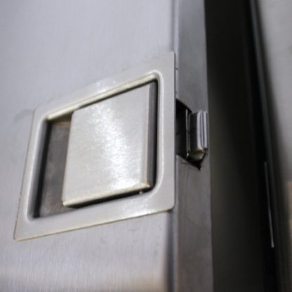 Close-up view of latch on EnviroPass® Fire Resistant Stainless Steel Pass-through with Solid-door