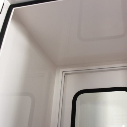 Close-up Interior View showing smooth coated walls of EnviroPass® Powder-Coated Mild Steel Pass-through with viewing window in door